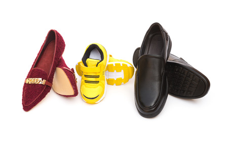 footware: three pairs of shoes for dad mom and son on a white background as family concept Stock Photo