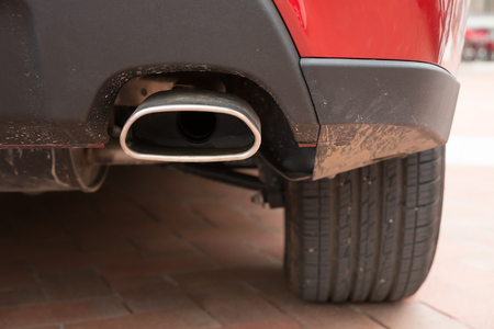 exhaust pipe: exhaust pipe of a red car