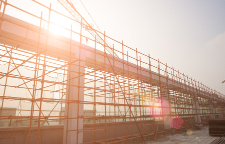construction work: construction site against the sun Stock Photo