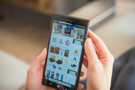 Zhongshan,China-November 27, 2015:young women shopping through mobile on Amazon on Black Friday. Redakční