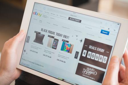 ebay: Zhongshan,China-November 27, 2015:young women shopping through tablet on Ebay on Black Friday. Editorial
