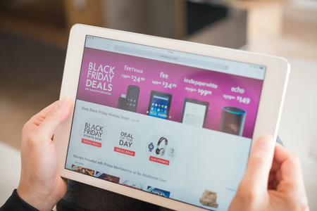 Zhongshan,China-November 27, 2015:young women shopping through tablet on Amazon on Black Friday.