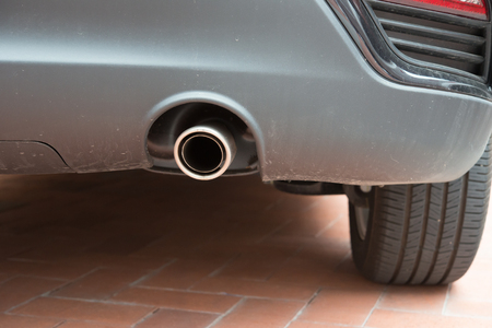 exhaust pipe: exhaust pipe of a silver car