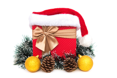 celebrate year: present box with christmas decoration and santa claus hat on a white background Stock Photo