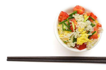 chop sticks: top view homemade fried rice with tomatoes and egg with chop sticks on white Stock Photo