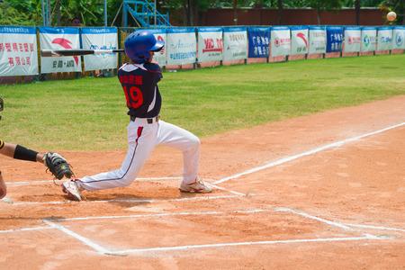 ZHONGSHAN PANDA CUP, ZHONGSHAN, GUANGDONG - August 4:unknown batter hitting the ball during a match of 2015 National Baseball Championship of Panda Cup on August 4, 2015. Editorial