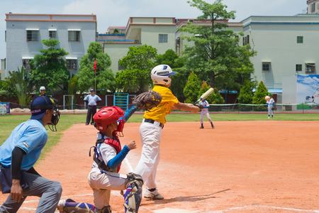 ZHONGSHAN PANDA CUP, ZHONGSHAN, GUANGDONG - August 3:unknown batter hitting the ball during a match of 2015 National Baseball Championship of Panda Cup on August 3, 2015.