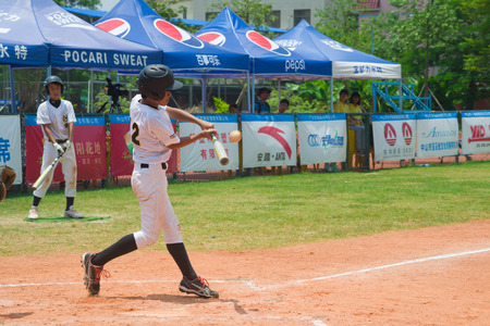 baseman: ZHONGSHAN PANDA CUP, ZHONGSHAN, GUANGDONG - August 4:unknown batter hitting the ball during a match of 2015 National Baseball Championship of Panda Cup on August 4, 2015. Editorial