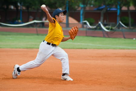 sphere base: ZHONGSHAN PANDA CUP, ZHONGSHAN, GUANGDONG - August 3:unknown pitcher throwing the ball during a match of 2015 National Baseball Championship of Panda Cup on August 3, 2015.
