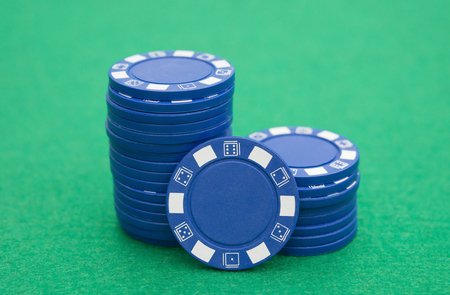 casino table: lots of blue poker chips on casino table