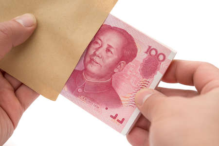 rmb: taking out stack of RMB paper currency from an envelope Stock Photo