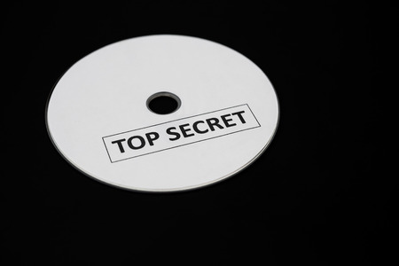 confide: compact disc with label of top secret on a black background