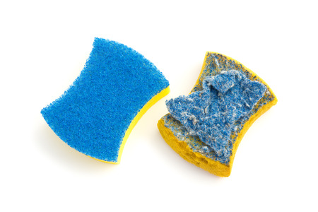 top view new & old double-side cleaning sponge on a white background Reklamní fotografie