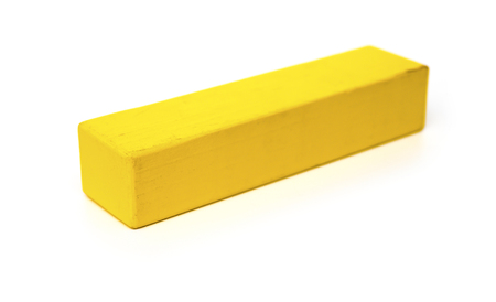 yellow block: piece of yellow wooden toy block on white background