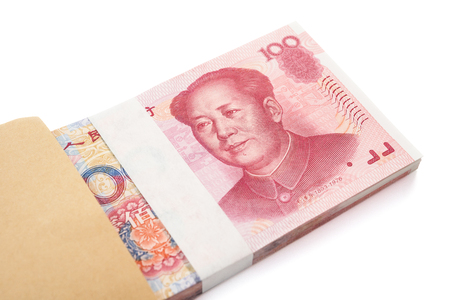 gift spending: stack of RMB paper currency in an envelope with clipping path