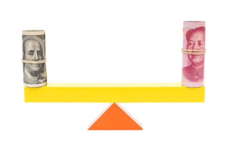 upvaluation: usd and rmb balance on teeterboard on white background Stock Photo