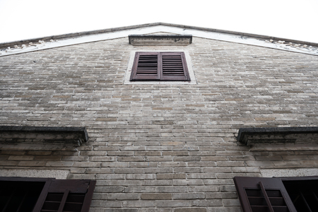 housetop: wall and roof of an old chinese house Editorial