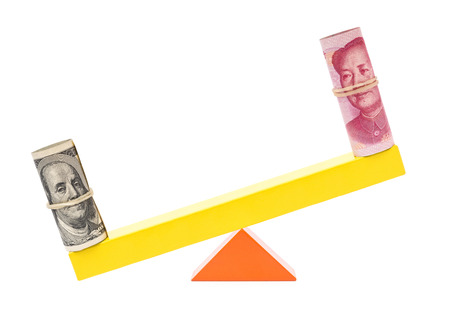 upvaluation: usd heavier than rmb on teeterboard on white background