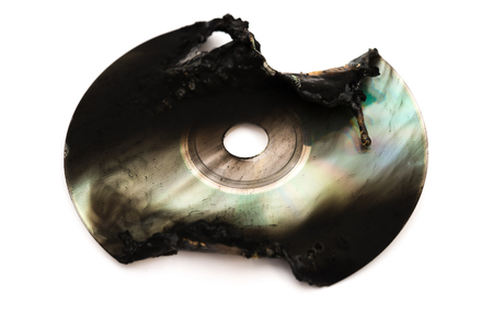 burnt out: burnt out cd on white Stock Photo