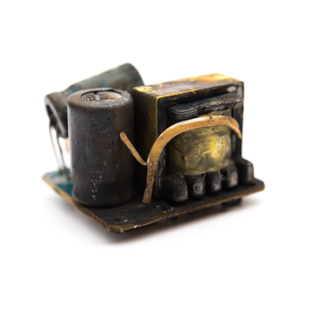 burnt out: burnt out core of a mobile recharger on white background