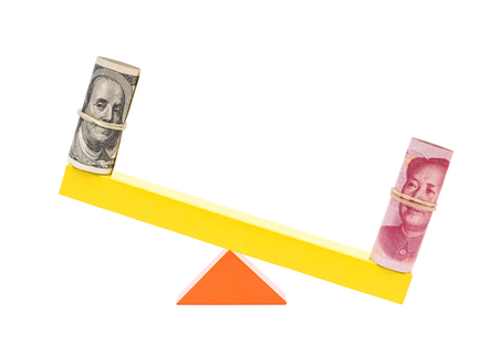 rmb heavier than  usd on teeterboard on white background