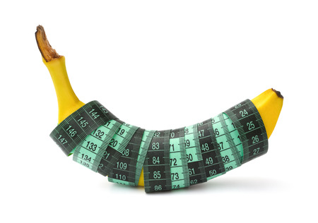 measuring tape: fresh banana wrapped with measuring tape