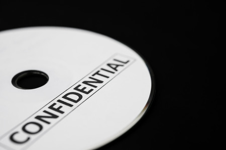 confide: confidential cd on black with copy space