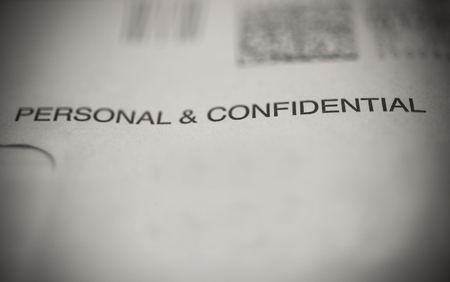 confide: envelope marked with personal & confidential Stock Photo