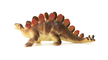 stegosaurus: side view brown stegosaurus toy on a white background