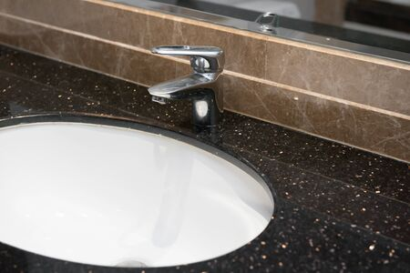 tap room: stainless steel water tap in a bath room