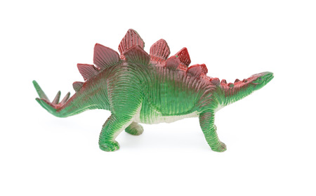 side view green stegosaurus toy on a white background Imagens