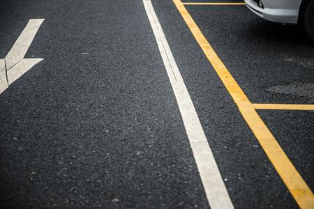 carpark: outdoor car parking lot with arrow sign