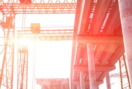 schlagbaum: concrete highway under construction against the sun