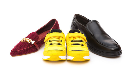 footware: shoes for dad mom and son on a white background Stock Photo
