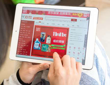 Zhongshan,China-November 11, 2015:young woman shopping on jd on Chinese online shopping day on November 11. Nov 11 is the shopping day in China and many online shops sale things in half price starts from Nov 1 until Nov 11.