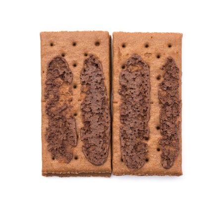 irresistible: top view chocolate flavor sandwich biscuits opened on a white background