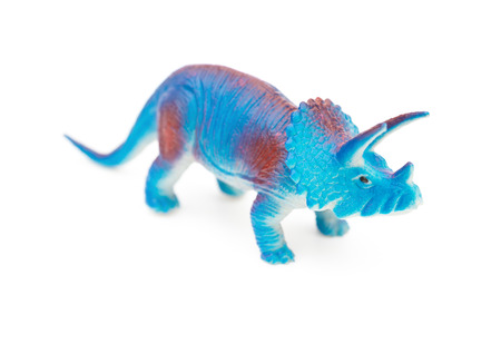 triceratops: blue triceratops toy on a white background