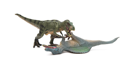 lays down: tyrannosaurus stands and spinosaurus lays down on a white background