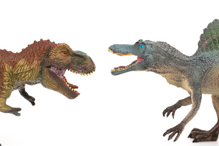 tyrannosaurus and spinosaurus toys on a white background Banco de Imagens
