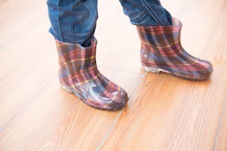 gumboots: kid wearing waterproof gumboots