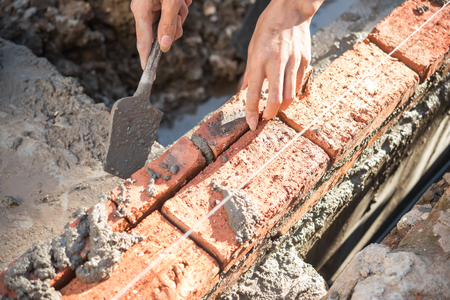plasterer: plasterer making up a brick wall with cement Stock Photo