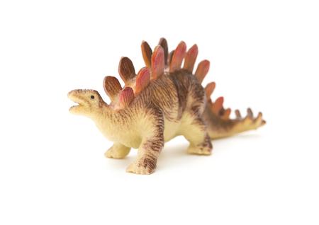 stegosaurus: estegosaurio juguete marr�n sobre un fondo blanco Foto de archivo