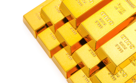 stacked up: pieces of gold bars stacked up on a white background