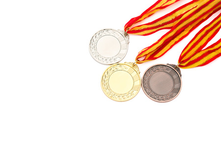 set of gold, silver and bronze award medals on white background