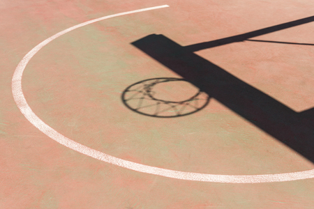 shadow of the hoop and board in a basketball court