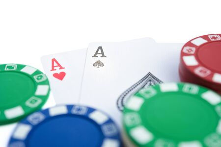 pokers: two Ace of pokers beside casino chips on  white with clipping path