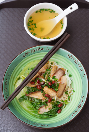 top view guilin rice noodles with bowl of soup nearby Stock Photo