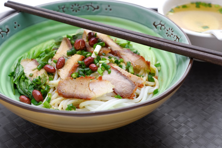guilin rice noodles with bowl of soup nearby Stock Photo