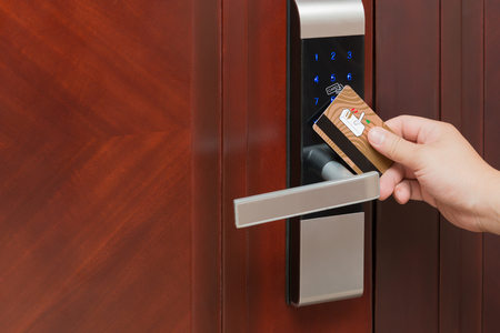 cardkey: electronic door lock opening by security card Stock Photo