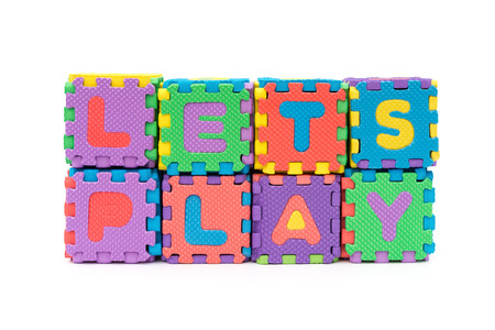 dexterity: letters of lets play made by alphabet jigsaw puzzle on white